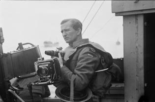 Bilde av en mann med et kamera